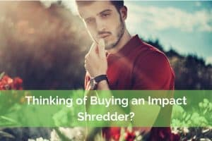 Man in garden thinking of buyinng and impact garden shredder