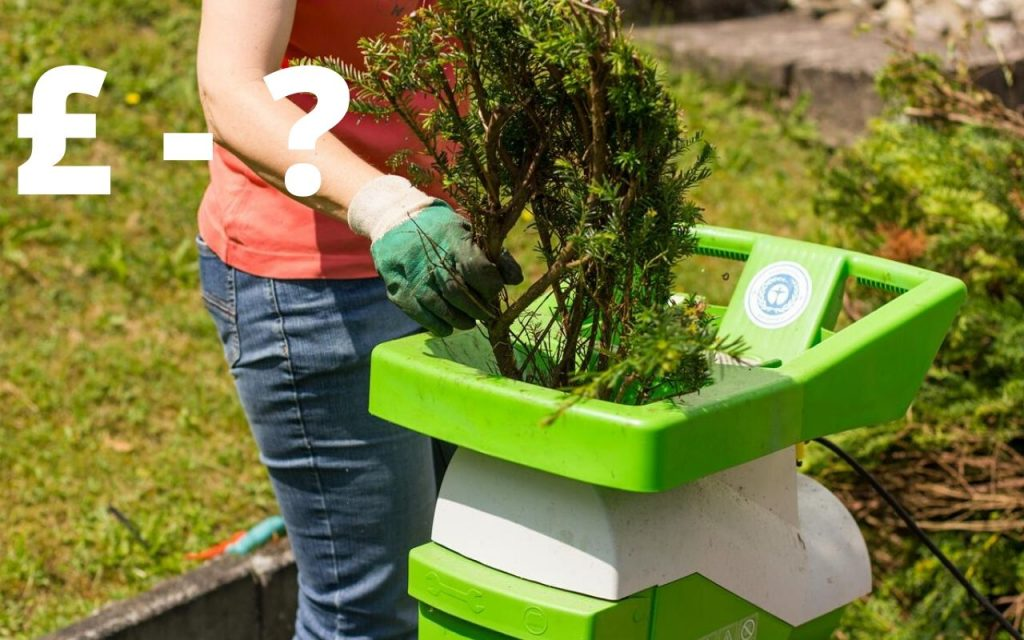 Are Garden Shredders Worth it - picture of woman using a shredder